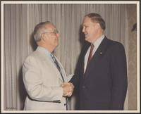 Photograph of William P. Clements and Representative Richard Smith, undated.