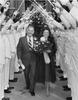 Bill and Rita Clements pass under the traditional arch during Clements 1979 inauguration. Photo courtesy of Texas State Library and Archives Commission
