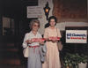 Clements supports holding bumper stickers during the 1986 campaign [e_cle_013454]